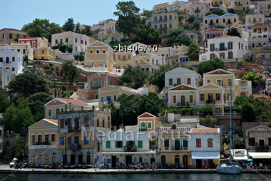 Typical Greece Seaside Town With Many Colorful Houses Built At Hill Over Sea Stock Photo