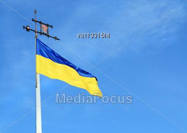 Ukrainian Flag On Flagpole Against Blue Sky Background Stock Photo
