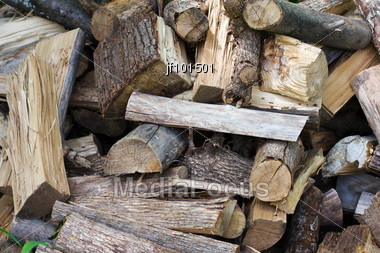 Uncut Firewood In An Unorganized Pile Stock Photo