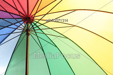 Under An Color Umbrella With Rain Drops Stock Photo