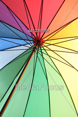 Under An Color Umbrella With Rain Drops Stock Photo