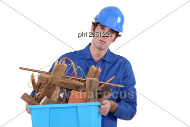 Unhappy Tradesman Taking Out The Recycling Stock Photo