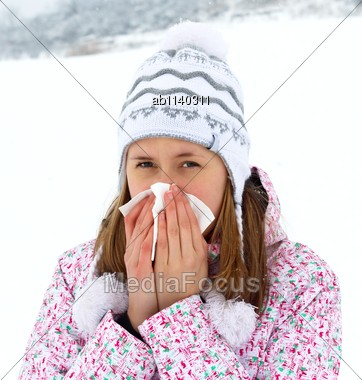 Unhealthy Woman Blowing Her Nose In The Cold Winter Stock Photo