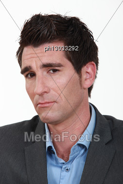 Unsure Businessman Stock Photo