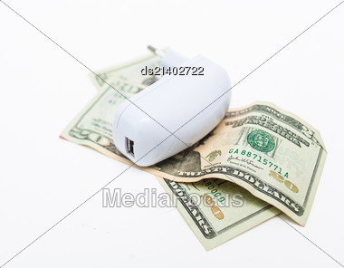 Usb-charger Over Heap Of Dollar On White Background. Economy Of Energy Concept Stock Photo