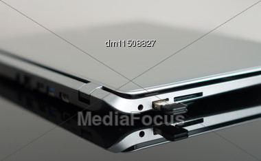 Usb Flash Drive Connected To Laptop Stock Photo