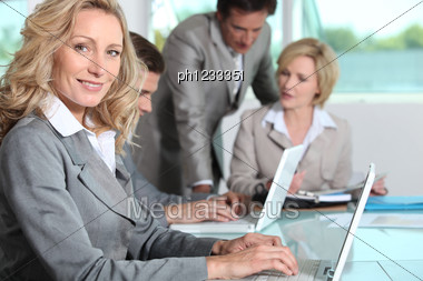 Using Laptops In An Office Stock Photo