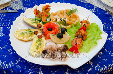 Variety Eatable Seafood Set On The Dish Stock Photo