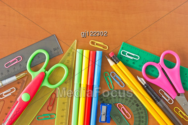 Various School Supplies On The Wooden Table Stock Photo