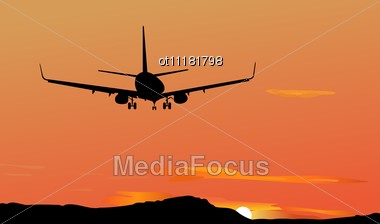 The Plane Against A Decline Stock Photo