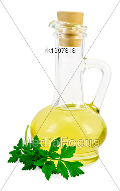 Vegetable Oil In A Glass Carafe With A Sprig Of Parsley Stock Photo