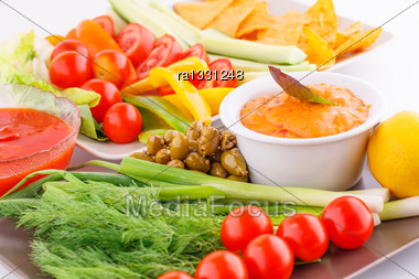 Vegetables, Olives, Nachos, Red And Cheese Sause Image Stock Photo