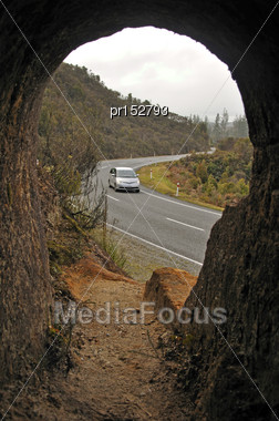 Vehicle Seen From An Old Gold Mine Entrance Near Charleston On The Coast Road, Westland, New Zealand Stock Photo