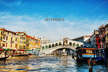 VENICE - DECEMBER 11: Rialto Bridge (Ponte Di Rialto) On A Sunny Day With Tourists On December 11, 2012 In Venice. It's Oldest And One Of The Four Bridges Spanning The Grand Canal In Venice Stock Photo