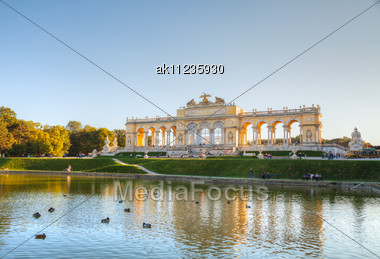 VIENNA - OCTOBER 06: Gloriette Schonbrunn At Sunset With Tourists On October 06, 2012 In Vienna. It's The Largest And Most Well-known Gloriette In Vienna Built In 1775 As The Last Building Constructed Stock Photo
