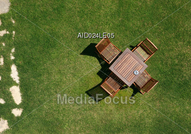 royalty free stock photo view from the top onto garden furniture on green lawn