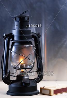 Vintage Burning Lantern Against Grunge Backgrounds. Abstract Still Life Stock Photo