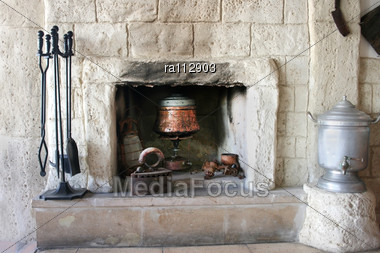 Vintage Fire-place With Kitchen Tools In Old House Stock Photo