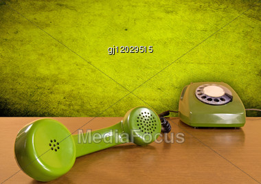 Vintage Green Telephone On The Wooden Table Stock Photo