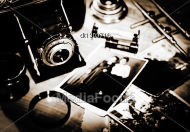 Vintage Still Life With Retro Photo Camera And Old Photos Stock Photo
