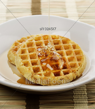 Waffles With Maple Syrup And Honey In A White Plate Stock Photo