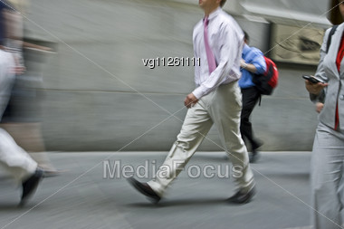 Walking Business People Rushing On The Street In Intentional Motion Blur,woman Using A Mobile Phone Stock Photo