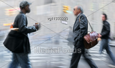 Walking Businessmen Rushing On The Street In Intentional Motion Blur, Man Carrying Morning Coffee Stock Photo