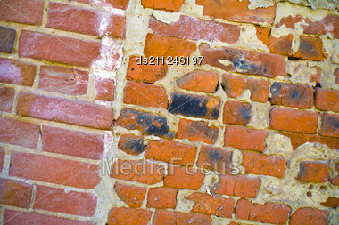 Wall Of Bricks Of Different Shape And Colour Stock Photo