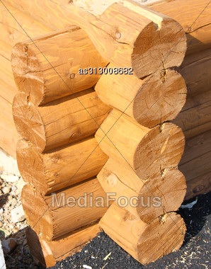 Wall Of A Rural Log House From The Fresh Cut Logs Stock Photo