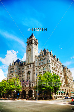 WASHINGTON, DC - MAY 8: Old Post Office Pavilion With Tourists In Washington, DC On May 8, 2013. It's Known As Old Post Office And Clock Tower And Officially Renamed The Nancy Hanks Center In 1983, Is Stock Photo