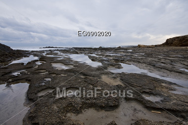 Water and rocks at the coastline Stock Photo