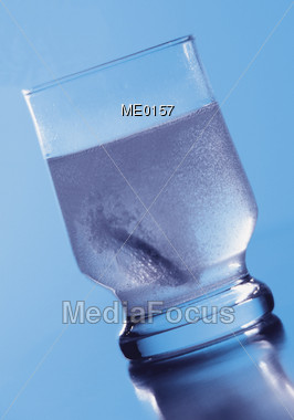 Water with Dissolving Pill Stock Photo
