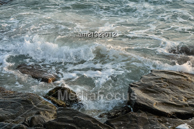 Waves Of The Caspian Sea Are Fighting On The Rocky Shore Stock Photo