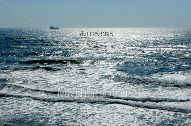 Waves Of The Mediterranean Sea In The Setting Sun Stock Photo