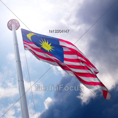 Waving Flag Of Malaysia On The Cloudy Sky Background Stock Photo