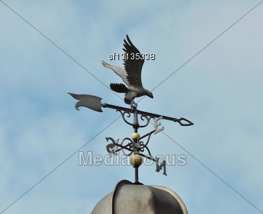 Weather Vane On A Roof Against A Sky Stock Photo