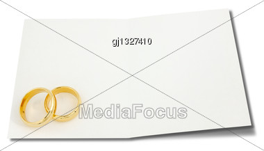 Wedding Rings On The Card For Text Over A White Background Stock Photo
