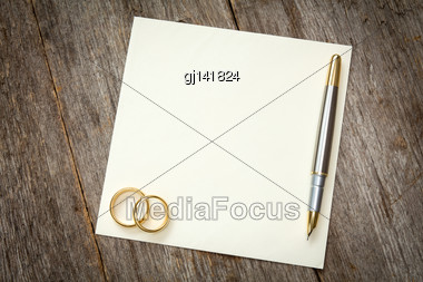 Wedding Rings On The Empty Card For Your Text Stock Photo