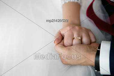Wedding Theme, Holding Hands Newlyweds. Close Up Stock Photo