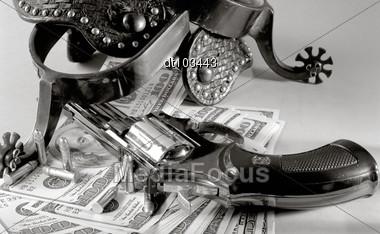 Western Still Life Over Money Background Stock Photo