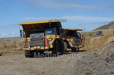 WESTPORT, NEW ZEALAND, MARCH 11, 2015: 130 Ton Loads Of Rock Overburden Are Carried Away At The Stockton Open Cast Coal Mine On March 11, 2015 Near Westport, New Zealand Stock Photo