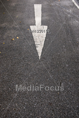 White Arrow On The Gray Asphalt, Road Sign Stock Photo