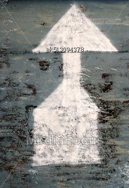 White Arrow On The Grunge Metal Stock Photo