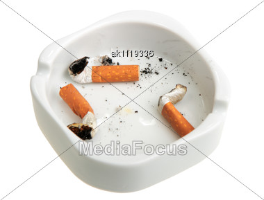 White Ashtray With Group A Smoking Butts. Close-up Stock Photo