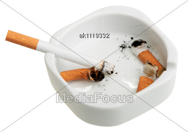 White Ashtray With A Smoking Butts And Cigarette. Close-up Stock Photo
