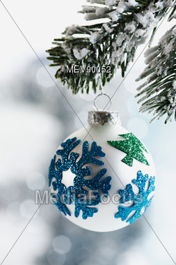 White & Blue Ornament Hanging From Fir Branch Stock Photo