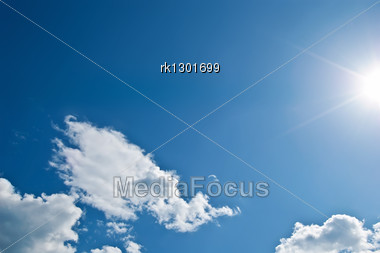 White Cloud In The Form Of A Dragon's Head And The Sun On The Background Blue Sky Stock Photo