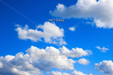 White Clouds In Blue Sky. Stock Photo