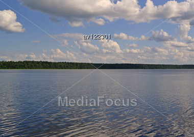 White Clouds Over Lake Water In The Summer Stock Photo