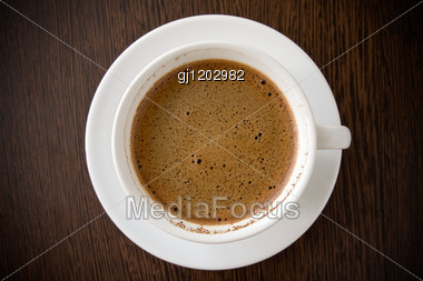 White Cup With Black Coffee On The Wooden Table Stock Photo